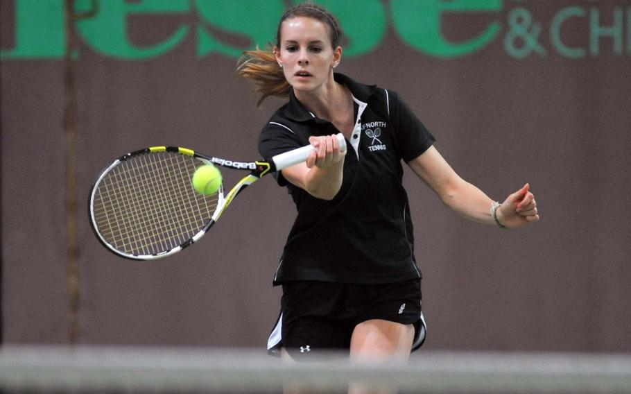AFNORTH's Hope Bonenclark rushes towards the net to return a shot by Wiesbaden's Jade Sullivan at the DODDS-Europe tennis championships in Wiesbaden, Germany, Friday, Oct. 25, 2013. Bonenclark fell to Sullivan, the top seed, 7-5, 6-2.