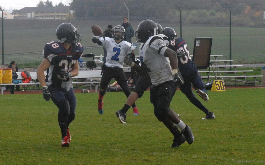 Hohenfels quarterback Clayton Pinheiro finds Jeantony Saintmelus for a fourth-quarter touchdown pass in Hohenfels' 38-28 Division II semifinal win Saturday, Oct. 26, at Bitburg, Germany.