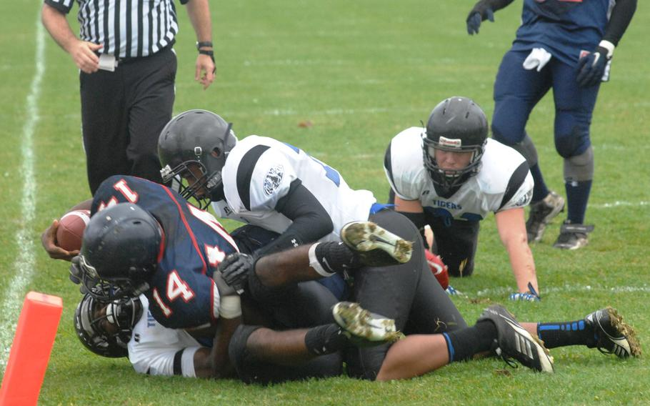 Hohenfels defenders stop Bitburg running back Larry Jackson short of a touchdown in Hohenfels' 38-28 Division II semifinal win Saturday, Oct. 26, at Bitburg, Germany.