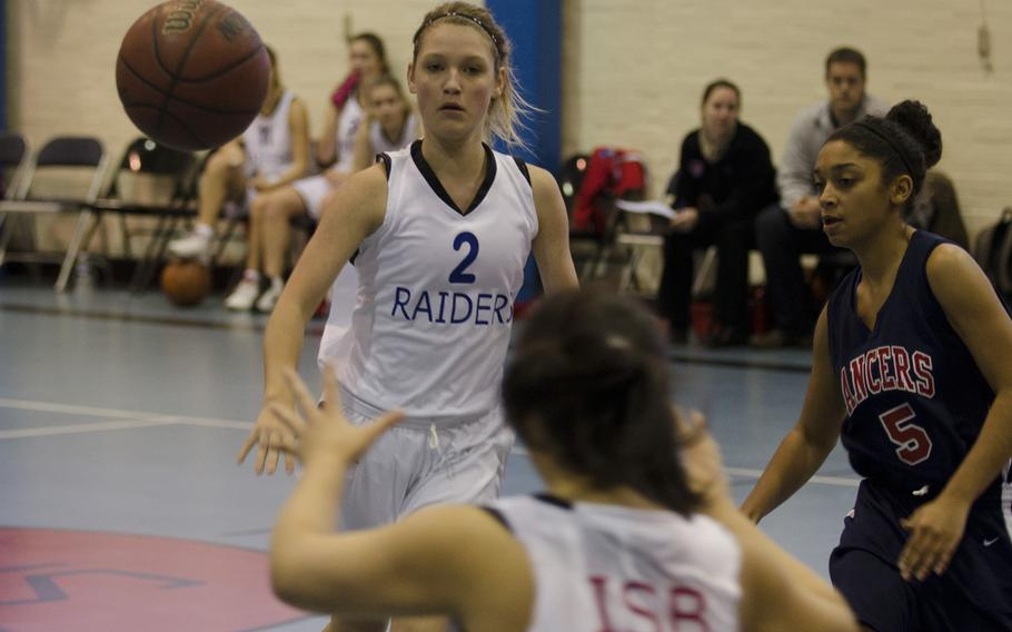 ISB 's Kelsey Adamitis tosses a pass during a game against the Lakenheath Lancers on Saturday at RAF Lakenheath, England. The ISB girls lost to Lakenheath 37-15.  Adam L. Mathis/Stars and Stripes