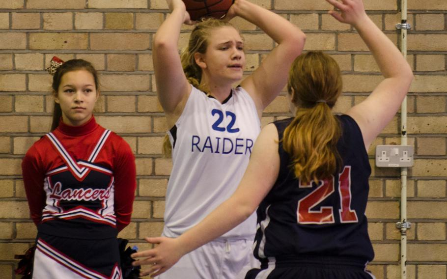 ISB's Kelsey Donnelly looks to put the ball in play while guarded by Lancer Kailey Kellner during a game at RAF Lakenheath, England, on Saturday.