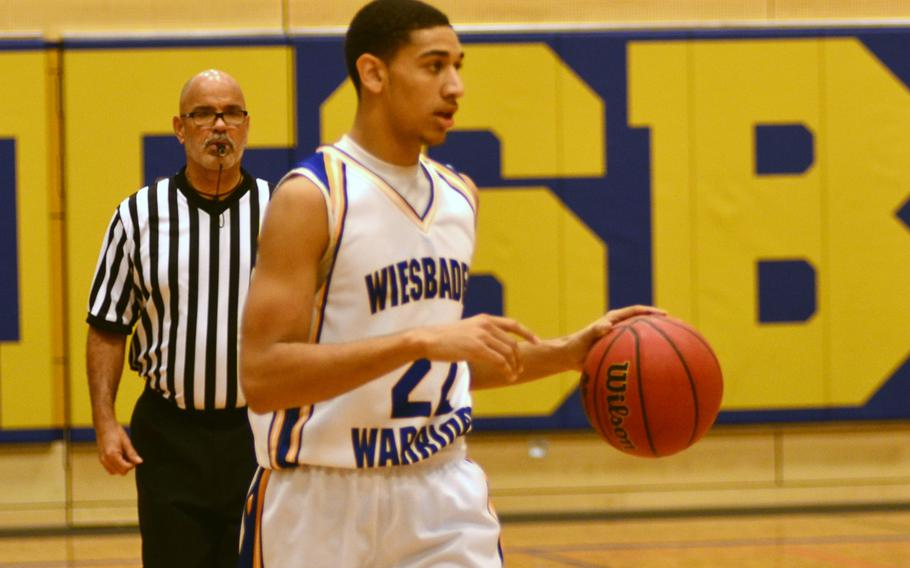 Wiesbaden's' Kelsey Thomas looks for opportunities down the court to score two of his 17 points.  Thomas was the Warriors' high scorer during the matchup with Kaiserslautern.