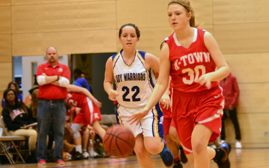 Kaiserslautern's Althea Honan dribbles past Wiesbaden's  Rebecca Russell on Saturday.  The Warriors went on to win in overtime 45-39.