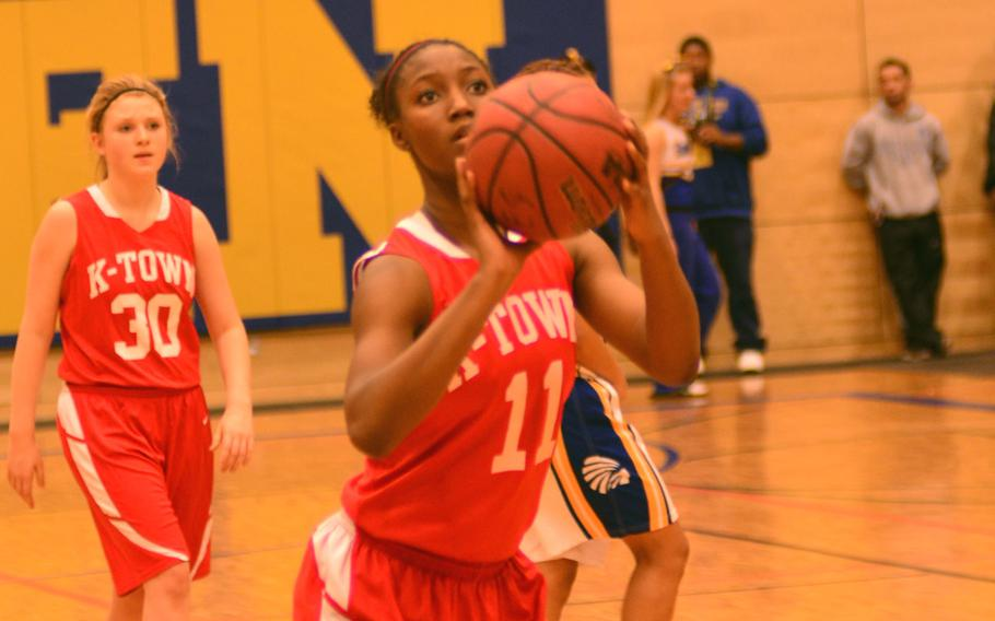 Kaiserslautern's Alana Dickerson prepares to score one of her eight points against Wiesbaden on Saturday.  After the Red Raiders' early lead, the Warriors came back to win 45-39.