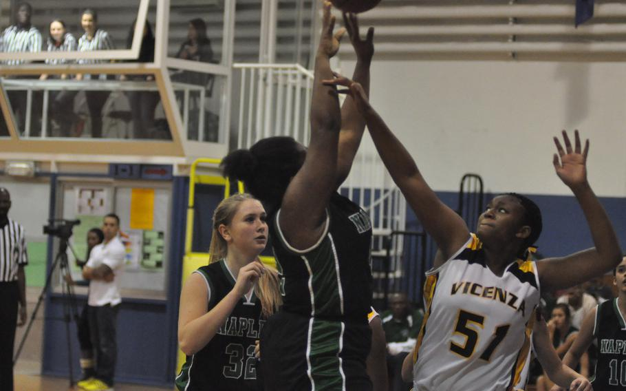 Naples senior Shanice Alexander shoots over Vicenza's Kianna Grant in the Willdats' 34-26 victory over the Cougars on Friday night.