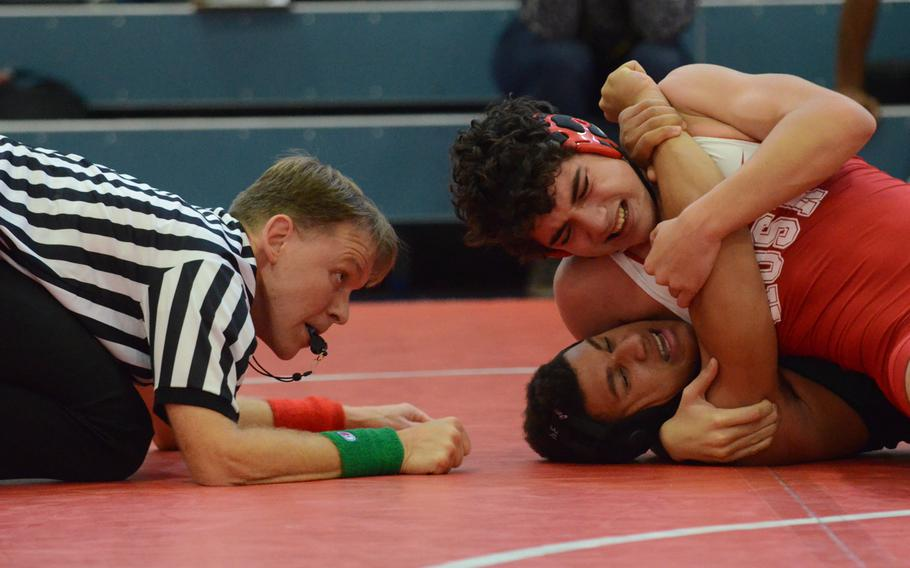 Referee Jon Ward watches as Emil Jurgens of American Overseas School of Rome attempts to pin Naples' Kory McKinney Saturday, during a 170-pound wrestling match at Aviano Air Base, Italy. McKinney would turn the match around and pin Jurgens in 5:20.