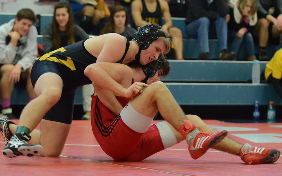Vicenza's Canaan York secures the back of Aviano's Jake Ellis Saturday, during a 152-pound wrestling match at Aviano Air Base, Italy. Canaan would defeat Ellis 15 seconds into the fourth round, securing first in their weight class.