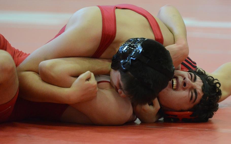 Aviano's Manny Gamboa pins Emil Jurgens of American Overseas School of Rome Saturday, during a match at Aviano Air Base, Italy. Gamboa pinned Jurgens in 1:49, which earned him first for his weight class.