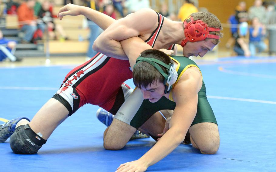 Kaiserslautern's Arvin Hrushka, left, beat Alconbury's Nick Dufresne in a 170-pound match in first round action on the first day of the DODDS-Europe wrestling championships in Wiesbaden, Germany, Friday, Feb. 14, 2014.