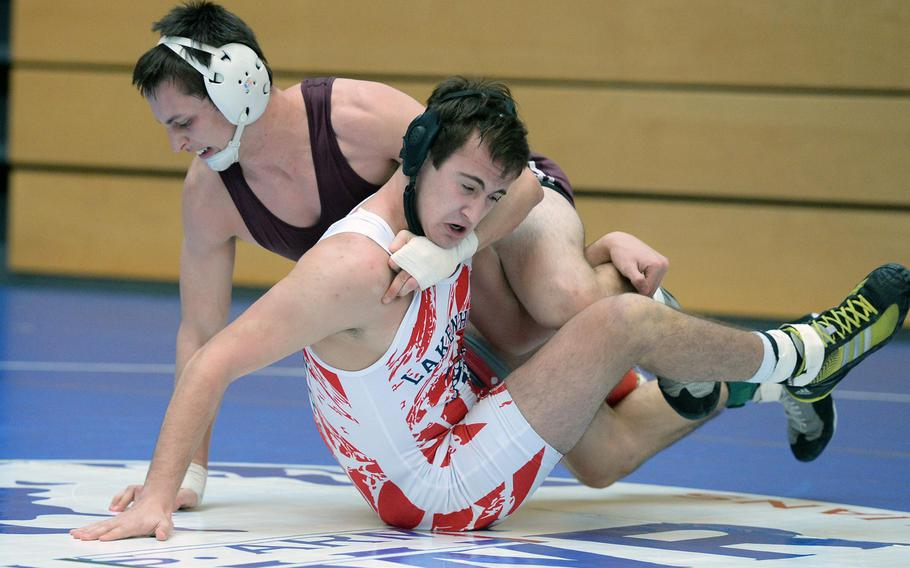 Vilseck's Will Peters, left, beat Lakenheath's Dillon Thompson in a 160-pound match in first round action on the first day of the DODDS-Europe wrestling championships in Wiesbaden, Germany, Friday, Feb. 14, 2014.