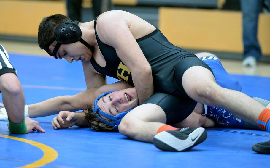 Vicenza's Joseph O'Hagan, top, beat Ramstein's Thomas Wilby in a 145-pound match in first round action on the first day of the DODDS-Europe wrestling championships in Wiesbaden, Germany, Friday, Feb. 14, 2014.