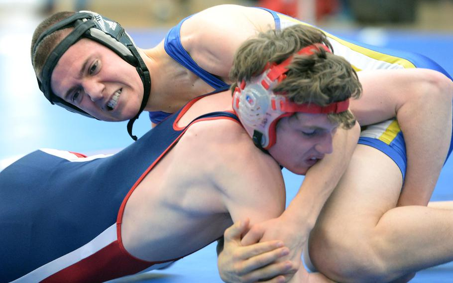 In a 132-pound match Wiesbaden's Caleb Magowan, top, beat Lakenheath's Richard Greszler in first round action on the first day of the DODDS-Europe wrestling championships in Wiesbaden, Germany, Friday, Feb. 14, 2014.
