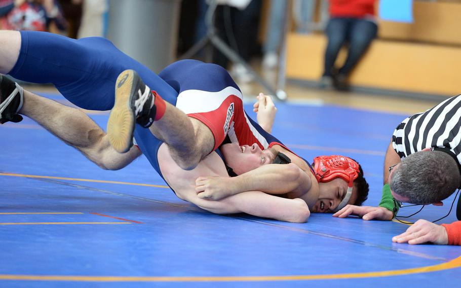 Black Forest Academy's David Crouch, left, struggles against Lakenheath's Keith Manibusan in a 126-pound match in first round action on the first day of the DODDS-Europe wrestling championships in Wiesbaden, Germany, Friday, Feb. 14, 2014.
