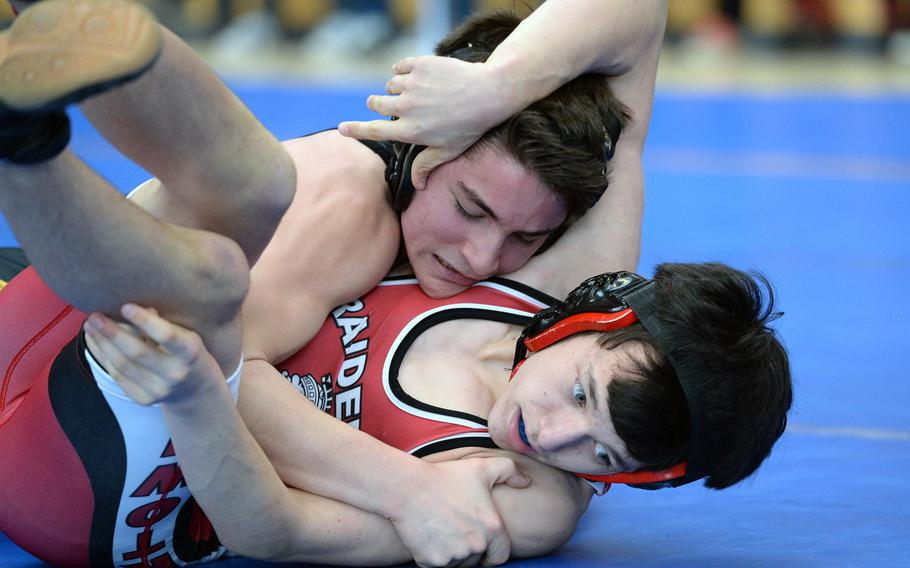 Vicenza's Drake Fichthorn, top beat Kaiserslautern's Evan Mackie in their 120-pound match in first round action on the first day of the DODDS-Europe wrestling championships in Wiesbaden, Germany, Friday, Feb. 14, 2014.