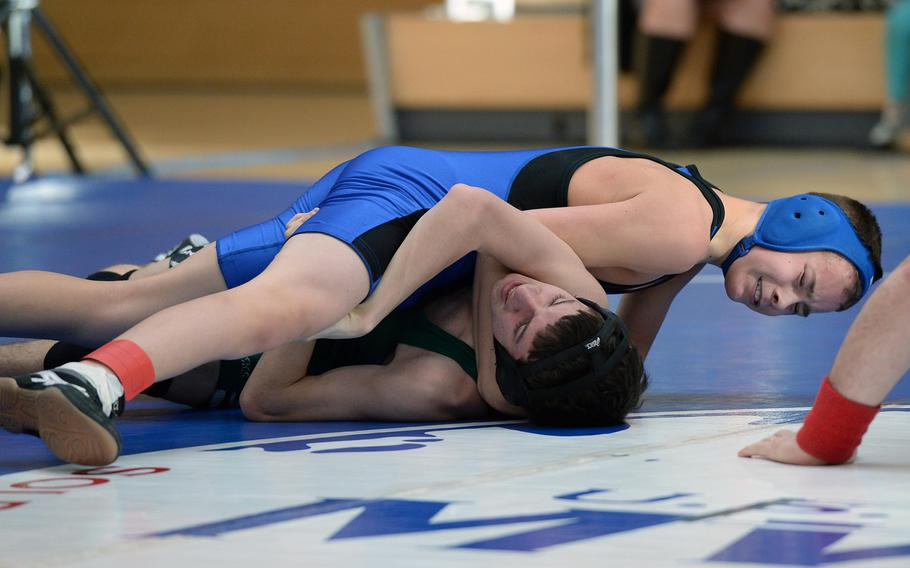 Incirlik's Baily Bennett, top, defeated Alec Williams of Naples in a 106-pound match in first round action on the first day of the DODDS-Europe wrestling championships in Wiesbaden, Germany, Friday, Feb. 14, 2014.