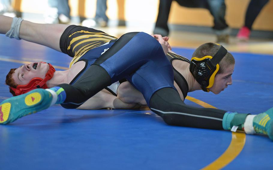 Patch's Matthew Bolduc, right, beat Bitburg's Kaleb Hoopes in a 106-pound match in first round action on the first day of the DODDS-Europe wrestling championships in Wiesbaden, Germany, Friday, Feb. 14, 2014.