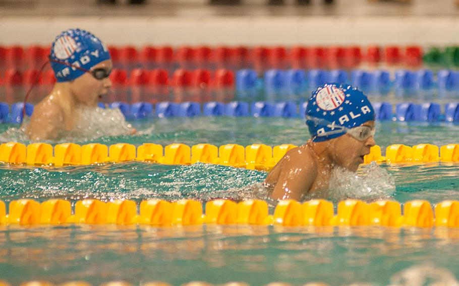 Kaiserslautern's Markos Ayala leads teammate Sam Grady during the boys 8 and under 200meter individual medley during the final day of the 2015 European Forces Swim League championships, March 1, 2015. Ayala won that race with a time of 3 minutes, 39.85 seconds.