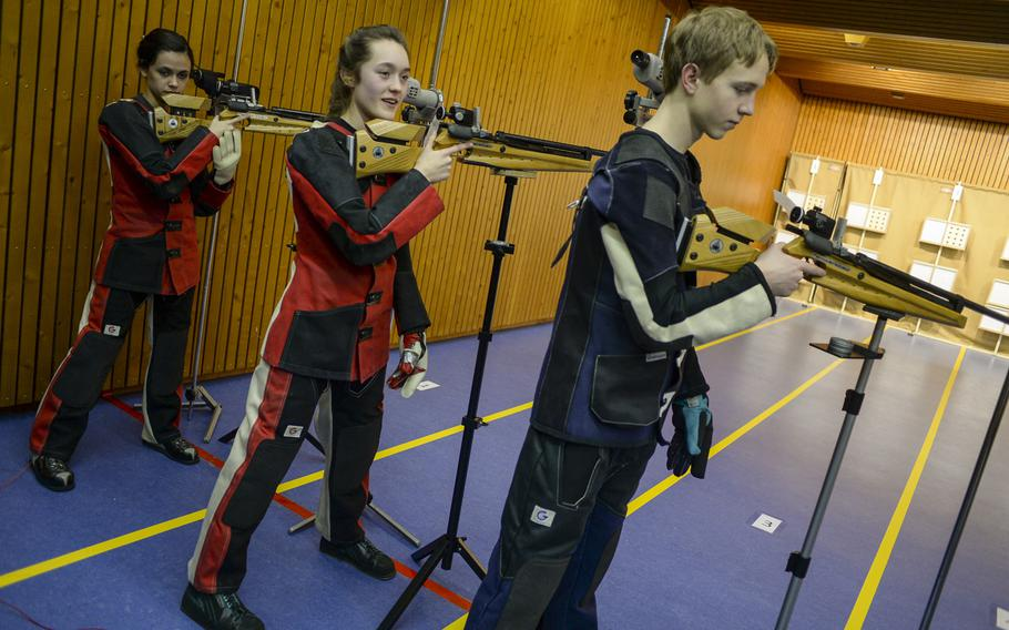 Patch's Maggie Ehmann, flanked by Caelyn Miller and Ben Ferguson, placed second at the DODDS European marksmanship championships last season, then won every meet including the championships this season.