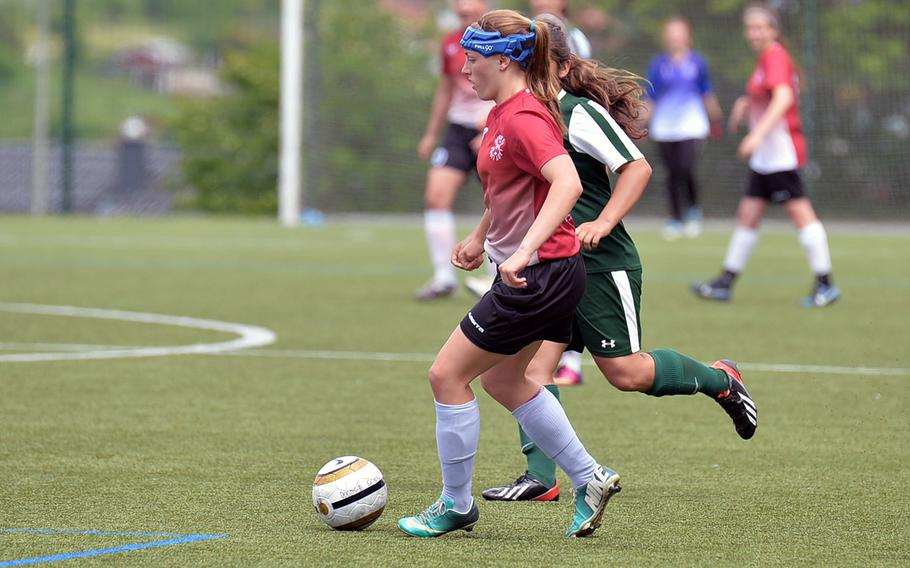 AFNORTH's Caitlyn Helwig takes the ball up the field against Alconbury at the DODDS-Europe soccer championships in Reichenbach, Germany, Wednesday, May 21, 2014. Helwig will be returning for the Lions when the 2015 season kicks off.