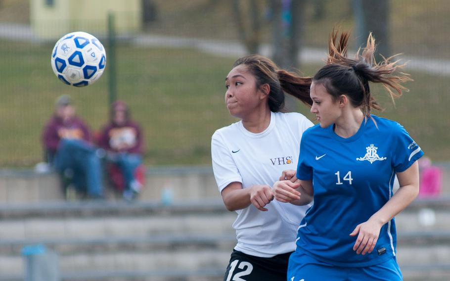 Vilseck's Kaylaah Capindo and Ramstein's Amanda Ambrose vie for a loose ball during the DODDS-Europe Division I soccer opener, Mar. 21, 2015. Ramstein won that contest 7-0.