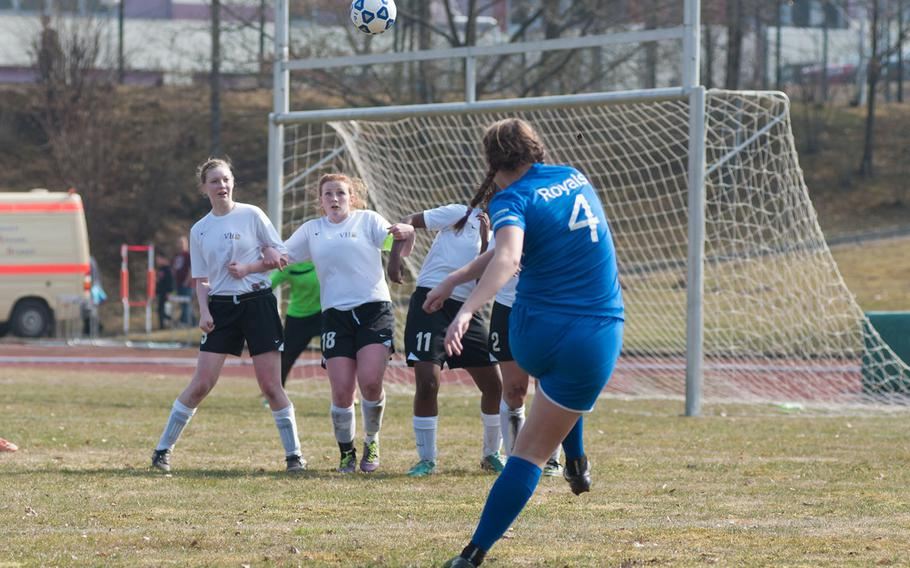 Ramstein's Lakyn Parker scores on a direct kick in the first half of the Royal's 7-0 victory over the Vilseck Falcons on Mar. 21, 2015.