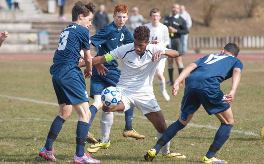 Vilseck team captain Pierre Elysee finds himself surrounded by Ramstein defenders during the Falcons' 2-1 upset over the Royals on  Mar. 21, 2015.