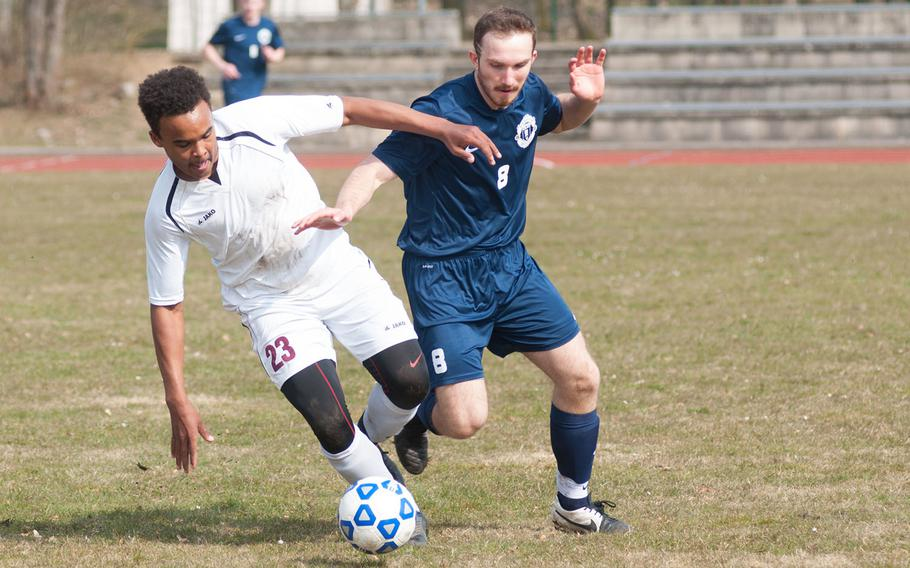 Vilseck's Malachi Alston fights for a ball with Ramstein's Dominic Kubas during the DODDS-Europe Division I soccer opener, Mar. 21, 2015. Alston scored one of Vilseck's two goals, lifting his team to victory, 2-1 over the visiting Royals.