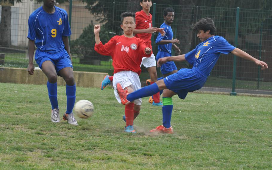 Ansbach's Edwin Pope gets off a kick right before American Overseas School of Rome's Jee-hoo Youn approaches.