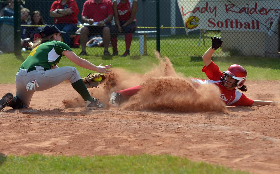 Kaiserslautern's Tierra Kienle slides into home as SHAPE's Hailey Van Valkenburg tries to put on  the tag. Kaiserslautern beat SHAPE 11-6 in a Division I game at the DODEA-Europe softball championships in Ramstein, Germany, Thursday, May 26, 2016.