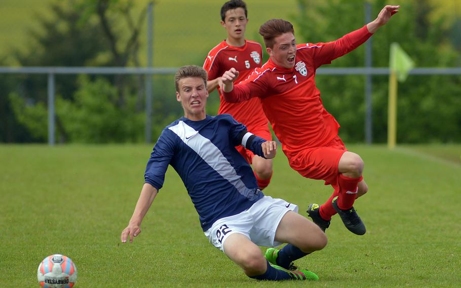 Lakenheath's Jacob Croft sends Kaiserslautern's Alex DeBella flying in Division I semifinal action at the DODEA-Europe soccer championships in Reichenbach-Steegen, Germany, Friday May 20, 2016. Lakenheath won the match in a shootout.