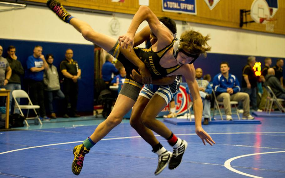 Ramstein's Tyler Kostos, rear, takes Stuttgart's Matthew Bolduc to the mat during a match at Ramstein Air Base, Germany, on Saturday, Jan. 14, 2017.