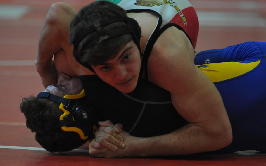 Naples' Frank Mastroianni puts Sigonella's Ethan Lopez to the mat in a 170-pound match Saturday, Jan. 14, 2017, at Aviano Air Base, Italy.