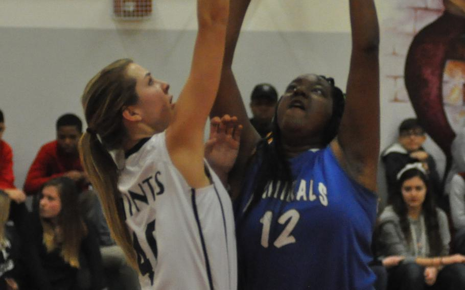 Rota's Laniyah Chester muscles up a basket - part of her game-high 15 points - in the Adrmirals' 47-31 victory over the Aviano Saints on Thursday in Italy.