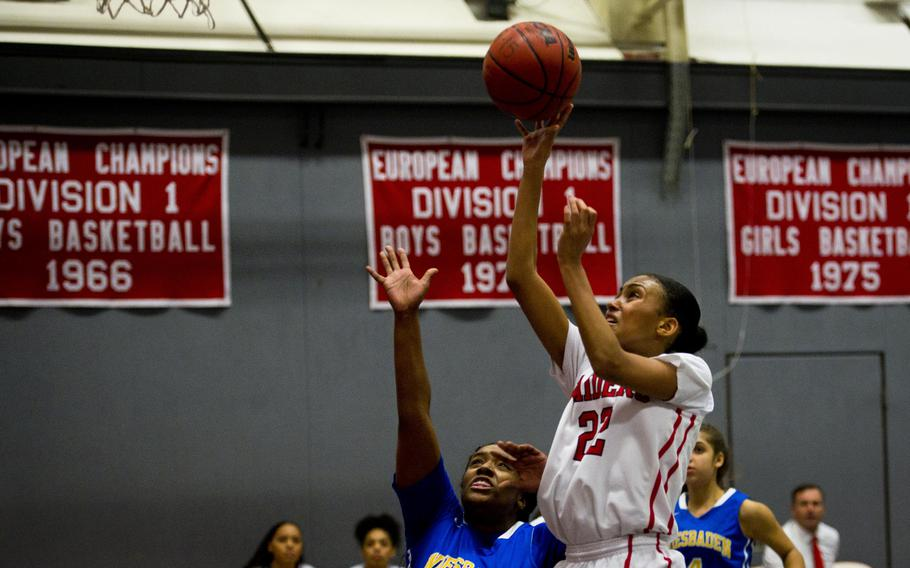 Kaiserslautern's Rana Robinson, right, goes up for a shot over Wiesbaden's Kiana Sterns at Vogelweh, Germany, on Friday, Jan. 20, 2017. Kaiserslautern won the game 31-20.