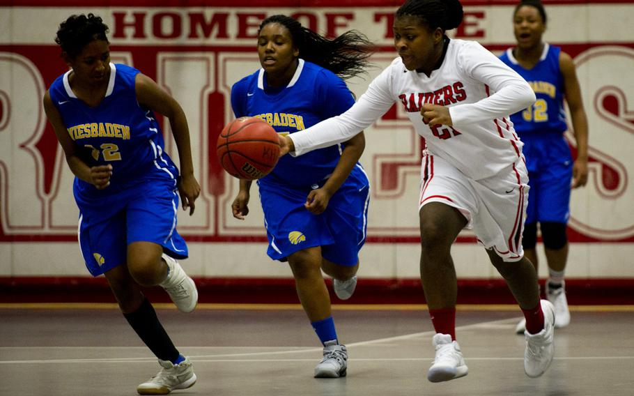 Wiesbaden's Corban Jackson, left, and Kiana Sterns try to catch Kaiserslautern's Le'Jhanique Brown at Vogelweh, Germany, on Friday, Jan. 20, 2017. Wiesbaden lost 31-20.