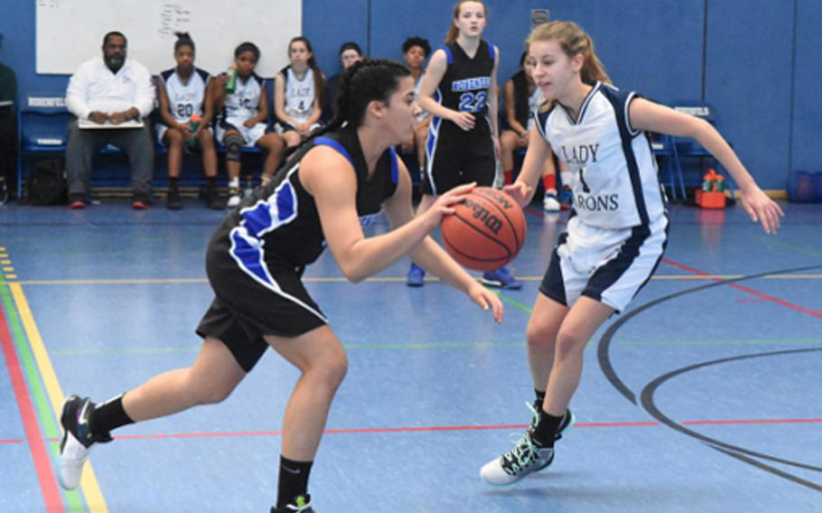 Hohenfels Tiger Alondra Saranno-Velez charges past Bitburg's Ava Bohn during a DODEA-Europe girls basketball game Saturday at Hohenfels, Germany.