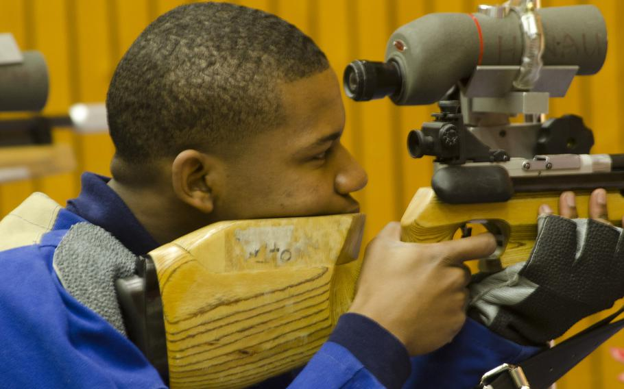 Davion Russell of Bitburg prepares to fire during a conference marksmanship competition in Wiesbaden, Saturday, Jan. 21, 2017. Russell finished first on his team with a 263.
