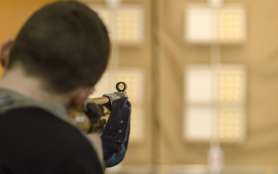James Wagenblast of Wiesbaden looks down his air rifle sights during a conference marksmanship competition in Wiesbaden, Saturday, Jan. 21, 2017. Wagenblast's varsity team finished third in the competition with a combined score of 1,074.