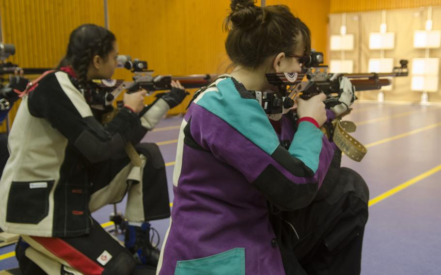 Victoria Jackson, left, and Renee Sahli, both of Kaiserslautern, prepare to fire during the kneeling portion during a conference marksmanship competition in Wiesbaden, Saturday, Jan. 21, 2017. Jackson and Sahli were the top two shooters, finishing with 281 and 276, respectively.