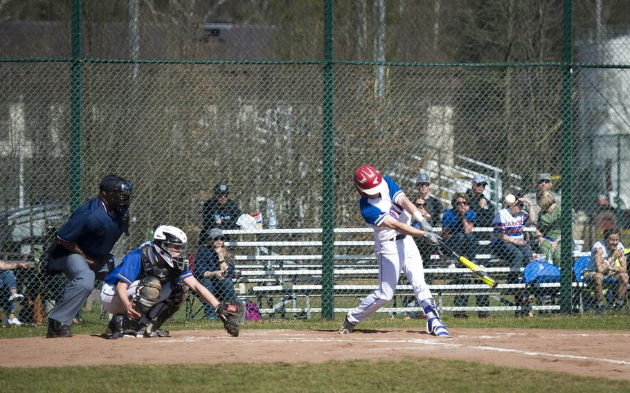 Ramstein's Aaron Schlosser gets a hit at Ramstein Air Base, Germany, on Thursday, March 30, 2017. Ramstein lost game one of the doubleheader against Wiesbaden 4-1, but won game two 13-3.