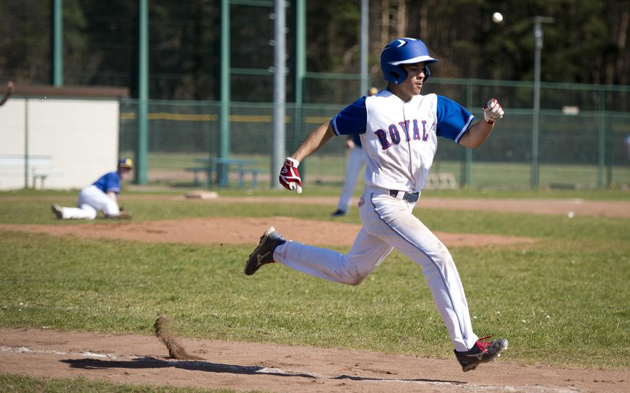 Ramstein's Stanley Cruz runs to first ahead of the ball at Ramstein Air Base, Germany, on Thursday, March 30, 2017. Ramstein lost game one of the doubleheader against Wiesbaden 4-1, but won game two 13-3.