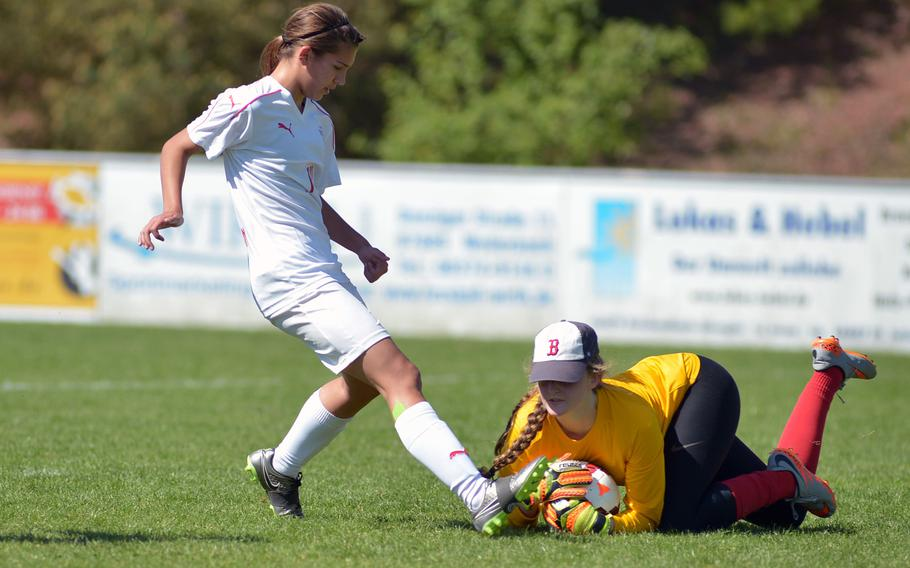 ISB's Jessica Sliter gets to the ball before Kaiserslautern's Aleysha Myers n a Division I game at the DODEA-Europe soccer championships in Reichenbach, Germany. Kaiserslautern won 2-0.