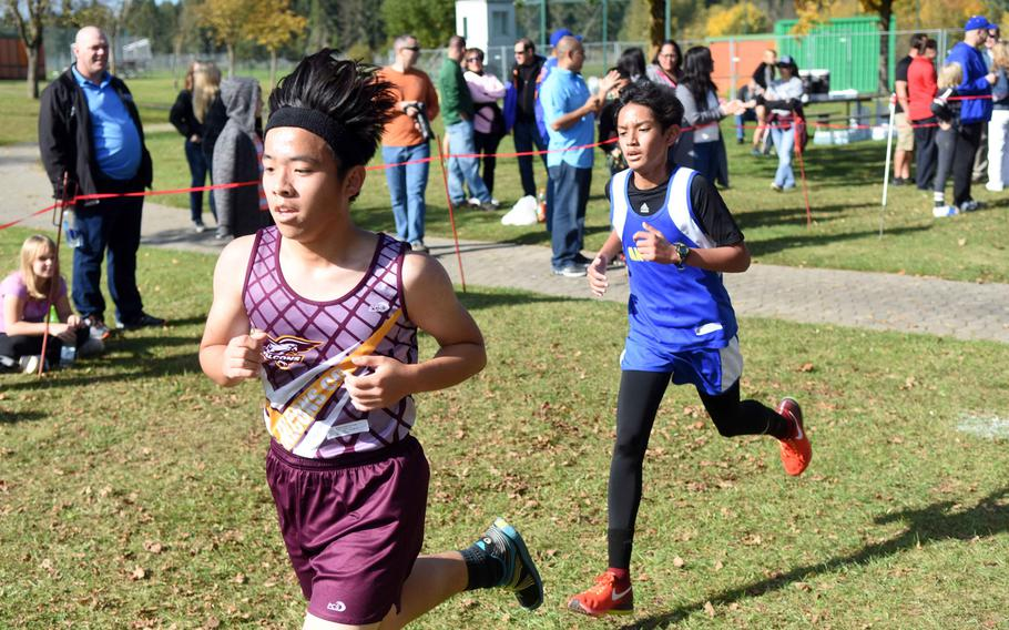 Vilseck's Frank Song runs ahead of Ansbach's Ljah Dumo at the cross country race at Vilseck, Germany, Sat., Oct. 14, 2017.