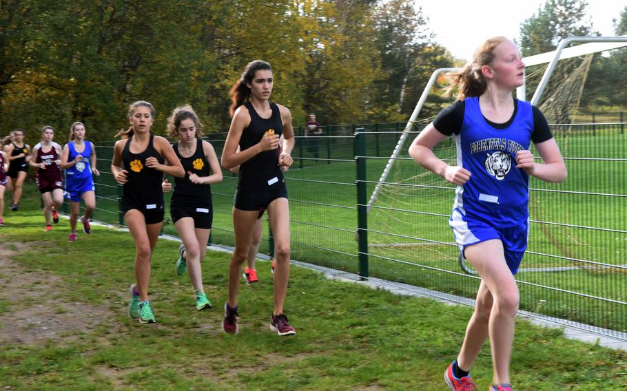 Ansbach's Chelsea Casanto runs ahead of a group of Stuttgart runners at the cross country race at Vilseck, Germany, Sat., Oct. 14, 2017.