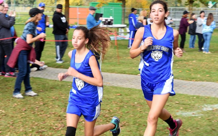 Hohenfels' Madison Higdon, left, and Miliannie Comas-Ramos  run at the cross country race at Vilseck, Germany, Sat., Oct. 14, 2017.