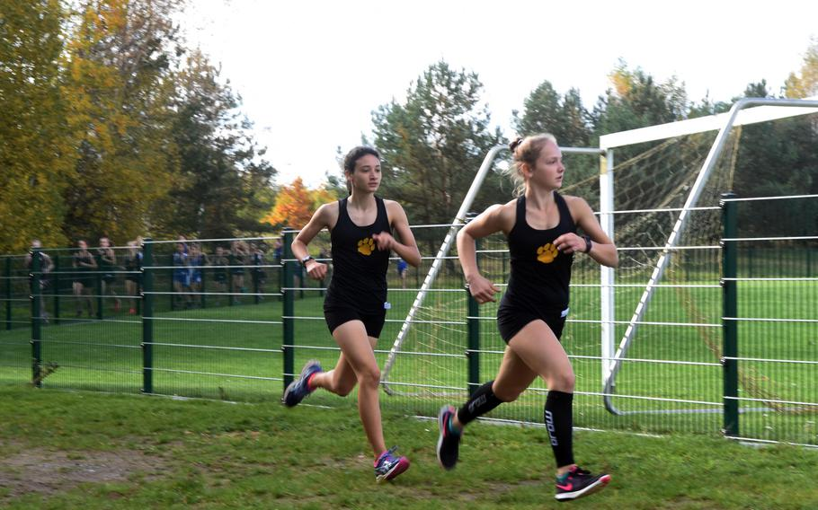 Stuttgart's McKinley Fielding runs ahead of her teammate Tatiana Smith, early in the cross country race at Vilseck, Germany, Saturday, Oct. 14, 2017.