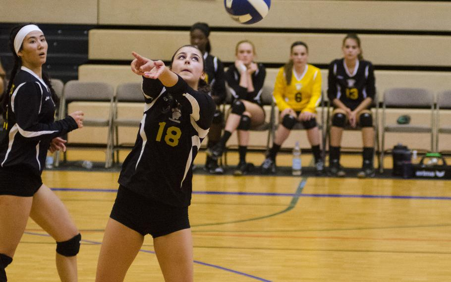 Stuttgart's Bella Brandt prepares to pass the volleyball in a match against Lakenheath in Wiesbaden, Germany, Saturday, Oct. 14, 2017. Stuttgart, last year's European champions, fell to Lakenheath but bounced back against Wiesbaden to split their two matchups.