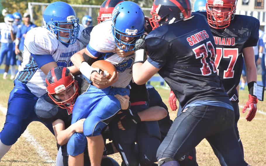 Aviano defenders stop Rota's Brennon Colvin for a short gain in the Saints' 33-30 victory over the Admirals on Saturday.