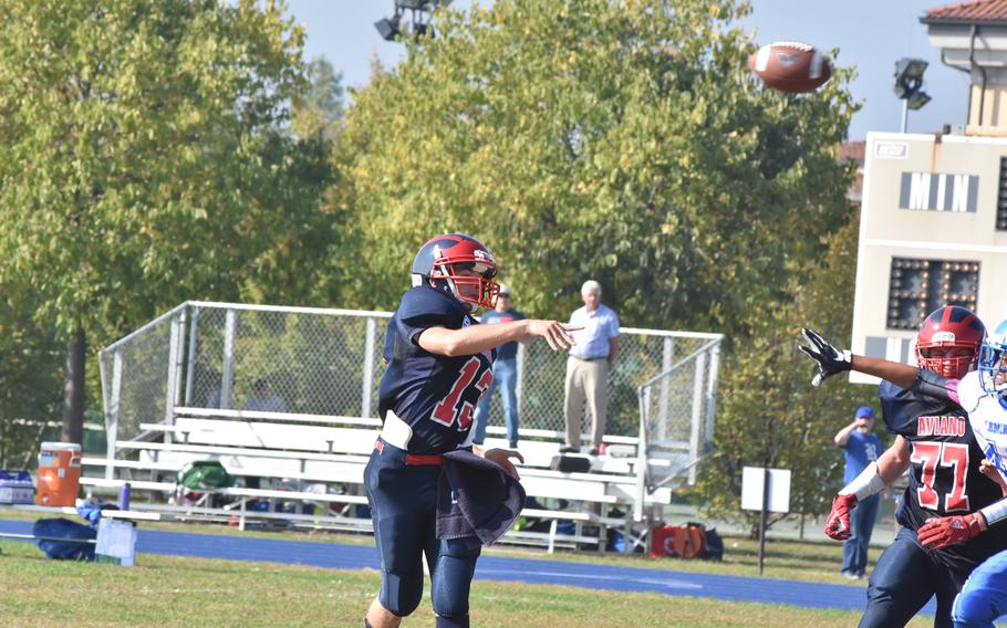 Aviano quarterback Mason Shine lofts the ball towards a receiver in the Saints' 33-30 victory over Rota on Saturday. Shine completed 11 passes for 165 yards.