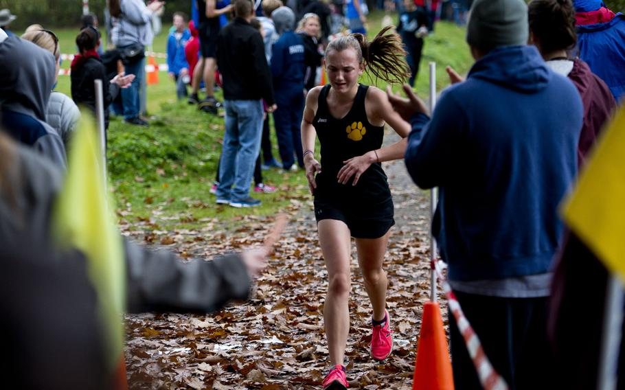 Stuttgart's Alycia Smith crosses the finish line at 21:13 for third place during a cross country meet in Ramstein-Miesenbach, Germany, on Saturday, Oct. 21, 2017.